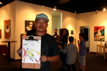 Ivan Garcia, 22, poses with his picture celebrating Phoenix art.