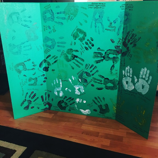 The Homeless Handboard. Residents from the Phoenix Rescue Mission display their hand prints, writing on one hand the stereotypes society places on them and on the other hand the type of they really are. (Photo by Kimberly Simpson)