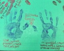 Residents from the Phoenix Rescue Mission display their hand prints. Writing on one hand the stereotypes society places on them and on the other hand the type of they really are. (Photo by Kimberly Simpson)