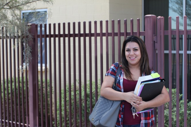 Zahide Betancourt, 28, holds her textbooks in front of Wilson Community Center in Phoenix, where she takes a GED prep course. (Photo by Cassie Ronda/PIN Bureau)